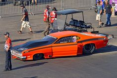 Brian Hicks 70 Plymouth Duster Powered By A Turbocharged-EFI Alcohol 526 Chrysler Hemi with 3 speed manual transmission