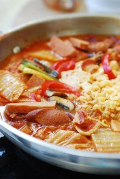 Budae jjigae - a Korean stew made with kimchi and American processed meats such as Spam, bacon and hot dogs. Here's my budae jjigae recipe. Spam Recipes, Cooking Recipes, Korean Recipes, Drink Recipes, Recipies, Dinner Recipes, Korean Dishes, Korean Food, Japanese Dishes