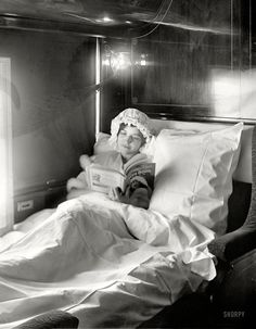 """Circa 1910. """"Electric-lighted berth on a deluxe overland limited train."""""""