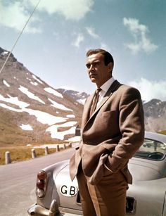 Sean Conneryas James Bond with his Aston Martin DB5 in 'Goldfinger, 1964.