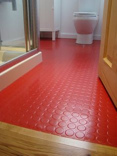 Red rubber flooring from Polyflor in bathroom                                                                                                                                                                                 More