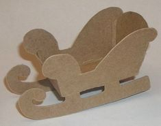 4 Cardboard Sleigh by littlevillagehouses on Etsy, $2.50