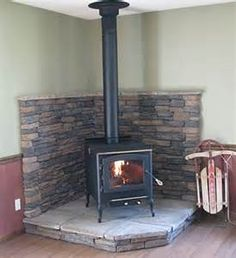 Corner Wood Stove on Pinterest | Wood Stove Hearth, Wood Stove ...