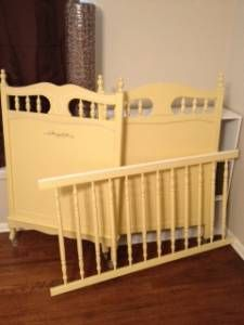 Vintage yellow baby crib