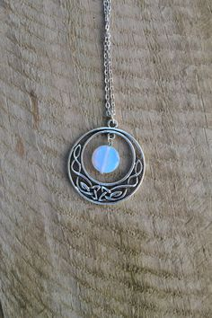 Beautiful silver celtic knot opalite moon pendant necklace. Outlander inspired, a simple but stunning piece by Valkyrie´s Song