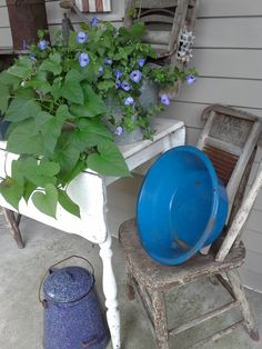 The old galvanized washtub and wringer were found separately, but they fit well and I turned them into a planter that sits on an old farm table on the front porch.