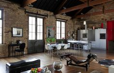 Love the whole vibe of this place - the exposed brick and beams and the contracts of the modern minimalist furniture. Unfortunately I can't find who the designer is for this. The source for me was House Crush and I think their source was 1stdibs.