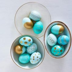 Golden Easter eggs: Give your Easter eggs extra dazzle with designs created from gold acrylic craft paint, a gold metallic-ink pad or a gold Sharpie paint marker. Details + more ideas for Easter egg decorating: http://www.midwestliving.com/holidays/easter/easy-easter-decorations/?page=4