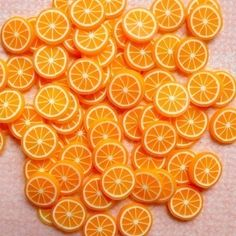 Orange Polymer Clay Cane Fruit Slices Fimo Cane Miniature Food Cake Ice Cream Sundae Kawaii Decoden Supplies Nail Art (75 to 100 pcs). $2.80, via Etsy.