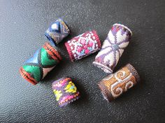Fabric Dreadlock Jewellery tubes HOLE SIZE: 8-10mm This are made by myself. It can DIY as decoration on your dreadlock, bracelets, rope.