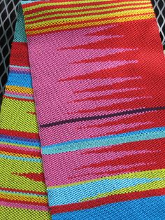 Saori-style banner woven with various colors of perle cotton; clasped-weft technique produces the diagonal patterns. Woven by Debbie Stringer.