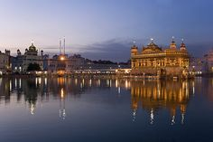 The magnificent Sikh Golden Temple of Amritsar glowing at dusk - Punjab, India