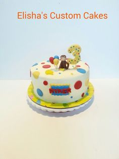 Curious George Cake.  Buttercream frosting with fondant accents.