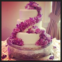 Beautiful spring cake with cascading purple flowers