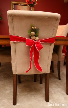 Parson chair Christmas ribbon - How to quickly add more bling to your dining room! Christmas Chair Covers, Christmas Cover, Christmas Tea, Christmas Ribbon, Christmas Kitchen, Merry Christmas, Christmas Christmas, Parson Chair Covers, Chair Back Covers