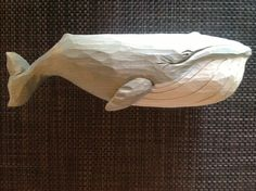 Hand carved wooden whale.  Bass wood, 10 X 3 X 2.  Private collection, Michigan.