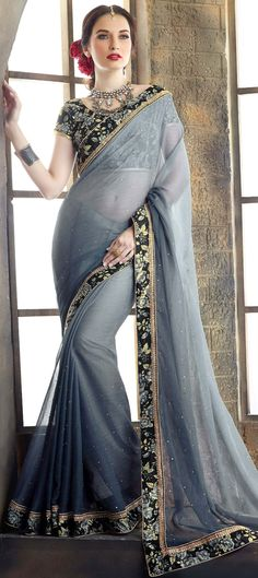 189680: Black and Grey color family Party Wear Sarees with matching unstitched blouse.