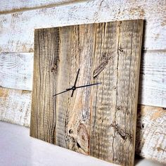 This would make a great housewarming gift! It would look great in any home, lodge/cabin, office, or on the fireplace mantle.  Each piece of reclaimed barn wood is very unique with its own characteristics: nail holes, cracks, notches and ax marks.  This rustic barn wood clock is handcrafted out of authentic barn wood. I pick out 3 complimentary pieces of wood for each clock. The 3 pieces are secured with pocket screws on the backside. I made this clock to look rustic and untouched. I ligh...