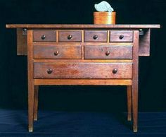 Shaker sewing cabinet with fold-out table top, Hancock, Massachusetts, circa 1830.