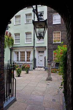 "Smallest square    London's smallest open public space is Pickering Place, off St. James's    Street, SW1—and alongside Berry Brothers and Rudd wine merchants,    established by the Widow Bourne in 1698. The widow's son-in-law, James    Pickering, created Pickering Court, which would later become notorious for    bear-baiting; as the site of the last duel fought with swords in London;    and, in a fact recorded on a plaque, the home of the legation, or embassy,    ""for the ministers from the…"