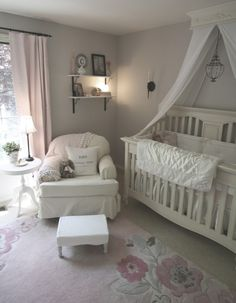 Love the neutrals in this room, as well as the mosquito netting around the crib...a must!