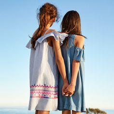 Set out on a summer adventure together in cool, off-the-shoulder sundresses. Shop now.