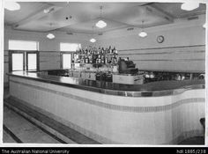 Public bar in the Exchange Hotel, High Street, West Maitland August 1941 View of a curved tile-faced linole.