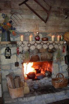 Cozy hearth. (Is that shiplap on the wall above the fireplace? And the whole dinner cooking in the fireplace? That is cozy!)