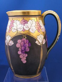 Limoges Pickard Lustre Grapes & Leaves Pitcher (Signed Robert Hessler/c.1905-1910) comes from the Ruby Lane Shop of Dark Flowers Antiques.
