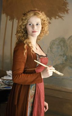 Reese Witherspoon with ginger red hair painting mural in movie Vanity Fair