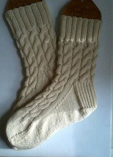 These socks are rustic, warm, thick socks. They do not have a close fit, but are excellent to wear as a second layer in winter, as a second layer over your normal cotton socks in your boots, when it gets really cold, or indoors as warm, cozy socks. This pattern is worked from the cuff down. The socks have a square heel and a standard, classic toe.