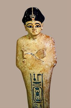 A yellow limestone shabti,one of hundreds found in the Tomb of Tutankhamun.