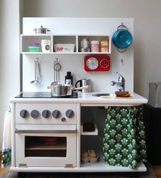 so much nicer than a plasic one - when I was a little girl (60 some years ago) I had a make believe stove and oven made from a shipping crate - I loved it.  Childrens Kitchen by Hyggelig #diy #upcycle