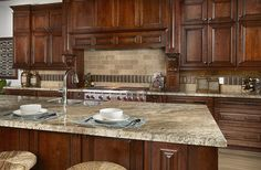 River Bordeaux Granite paired with Mexican Noce Tumbled Travertine- classic…