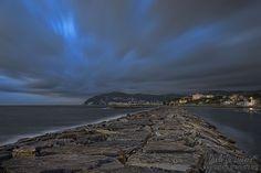 Dark sky over the Gulf of Diano Marina by dlddanilo