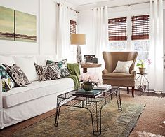 "Great tip! ""Exposed-leg furniture airs out a space, but every room needs a little grounding. Here, the skirted sofa is up for the job. Without it, the leggy pieces would look as if they were ready to walk away."" More Tricks for Small Living Rooms at the link."