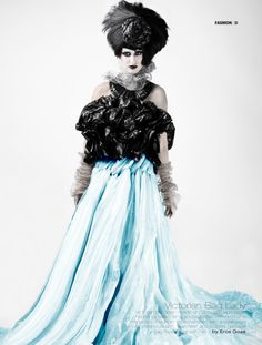 Trash bag dress accented with steel wool.  Wow!