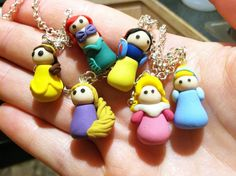 Disney princess inspired charms I made using polymer clay for a Disney trip- my daughter LOVED the necklace I made with them. I have no art skills, but the clay was so easy to work with and blend custom colors from!