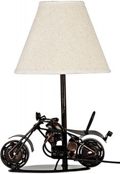 With its classy and trendy look, this uniquely designed table lamp from the house of Truhome will surely speak volumes about your aesthetic sense. This metallic table lamp with its motorbike design lends a classic look to your living room.