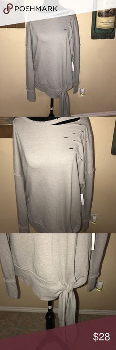 Super cute distressed sweatshirt Super cute distressed sweatshirt with bow at the bottom. So many ways to wear this. With leggings, jeans. Very versatile Abound Tops Sweatshirts & Hoodies