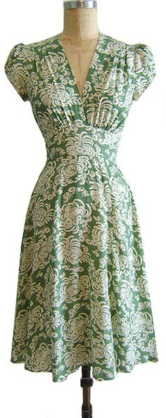 Vintage Fashion: I love this green dress with white floral pattern.