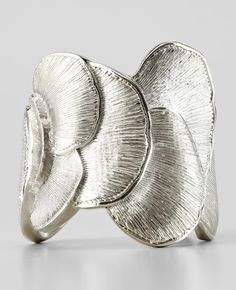 Cuff | Ann Taylor. 'Seashell statement'.  Silver metal.