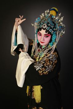 Between 1790 and the 1840s, Beijing opera evolved. It was mainly a court entertainment, and its performers wore striking make up and bright costumes to show the personalities of their characters. Beijing opera performers used graceful, symbolic movements rather than acting realistically.