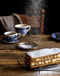 Milk tart mille feuille – Melkkos & Merlot Milk tart mille feuille – a traditional SA favourite gets a bit of French attitude! Sago Recipes, Steak And Kidney Pie, Yummy Treats, Sweet Treats, Melktert, African Dessert, High Tea Food, Coconut Tart, Fotografia
