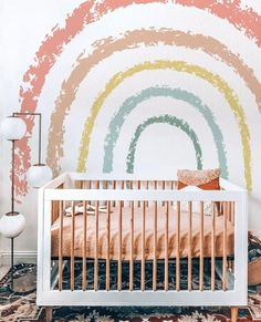 Gorgeous rainbow mural over crib! Mural by @betapetwallpapers⁠