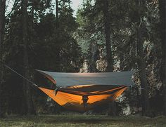 Kammok Glider - Made of lightweight, waterproof Amphibiskin fabric and backed by adventurer Bear Grylls, the Glider is a tarp slash camping shelter that also happens to work as a drinking water retention system. | Werd