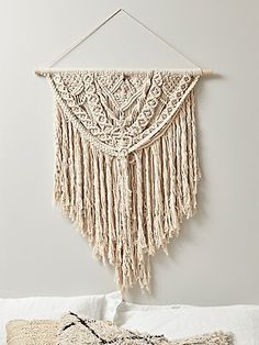 Made from super soft cotton in a sumptuous cream colour, our elegant tasselled macrame will complement any boho interior. This macrame wall hanging will adorn your walls and add a travellers touch to your space.