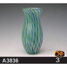 Uniquely hand blown glass bowl and plate, created using timeless glass blowing, cutting, or folding techniques that requires patience, strength,  precision. Blown Glass craft consists of many high quality art glass with twist horns and pods.The material is hand blown glass. $92.00