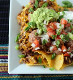 @Eunice Stafford, I see something like this the next time we do taco night! Beef Nachos with Homemade Pico de Gallo and Guac (dinner tonight)