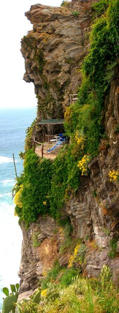 CINQUE TERRE ITALY - A hidden deck where guests can gaze out over the sea in the village of Vernazza.